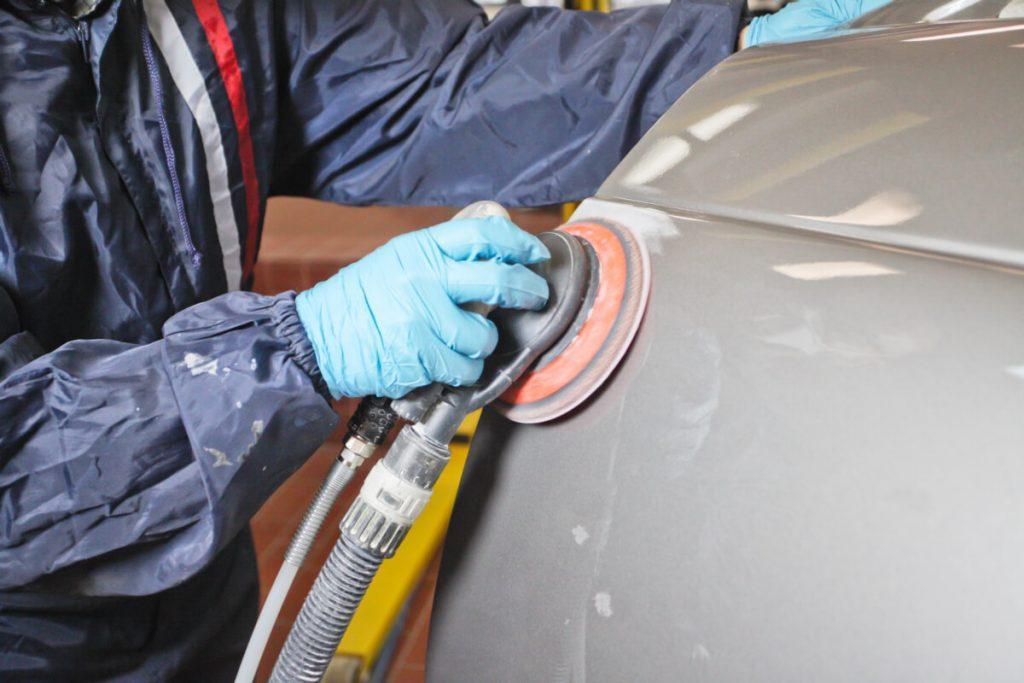 Sanding an Auto Body with an Air Orbital Sander