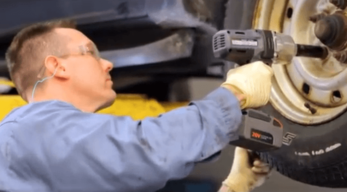Auto mechanic using Ingersoll Rand W7150-K2 Impact Wrench to remove a wheel