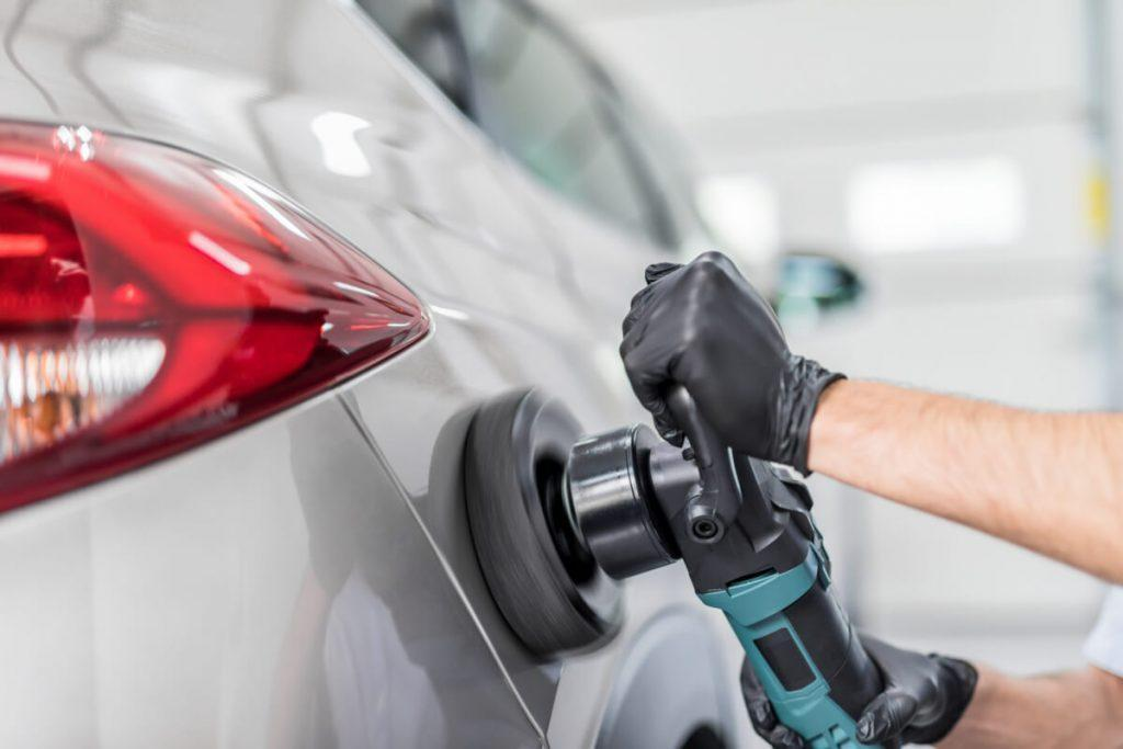 Detailing professional polishing a car