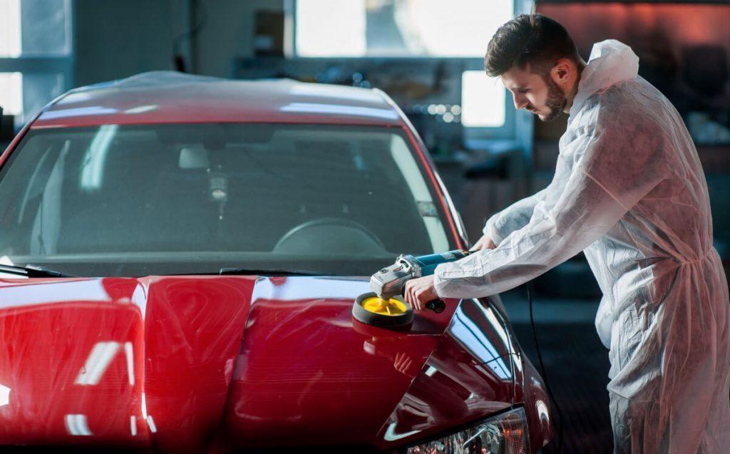 detailing tech polishing a car