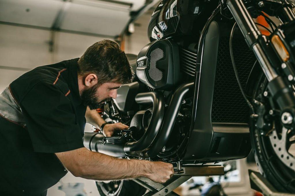 Mechanic working with motorcycle jack