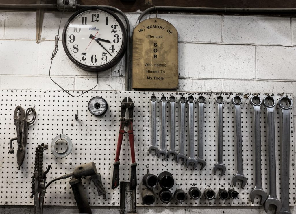 small pegboard and wrenches