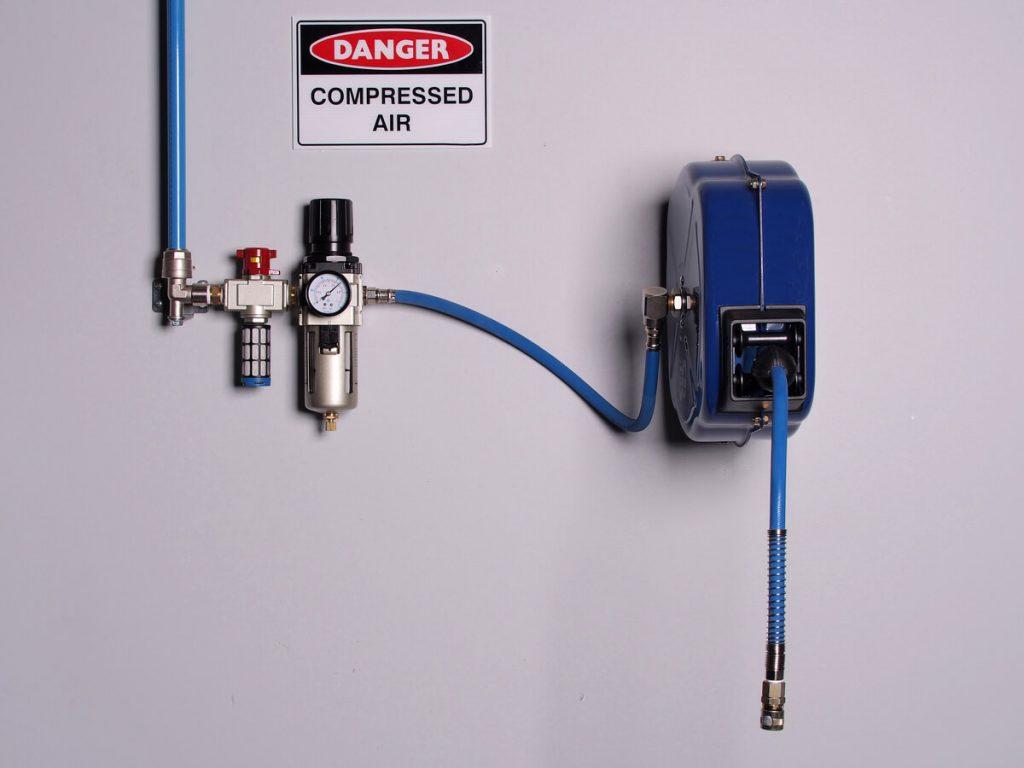 Blue wall-mounted air hose reel