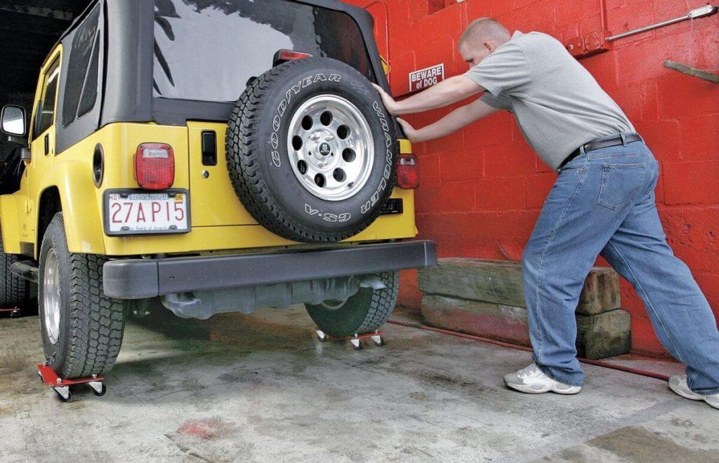 Jeep on car dollies